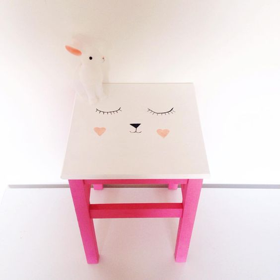 a cute IKEA Oddvar stool hacked with bright pink paint and a cute bunny face on top for a kids' room