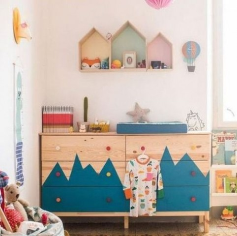 a double Tarva dresser with a mountain-inspired pattern and colorful knobs for an adventure-themed kid's room