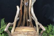 a garden chair of driftwood and some usual wood will be a nice idea for outdoors and it looks cool and lovely