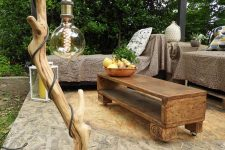 a gorgeous outdoor driftwood floor lamp with an oversized bulb is a beautiful idea for an oitdoor space and it's easy to craft