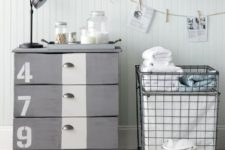 a grey IKEA Tarva hack with a white stripe, numbers, vintage knobs and casters for an industrial space