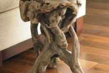 a little and cool driftwood side table made of a single piece of driftwood is a lovely way to reuse some driftwood making it a statement decor piece