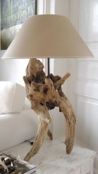 a lovely driftwood table lamp of a cool piece of driftwood and a neutral lampshade is a stylish solution to go for