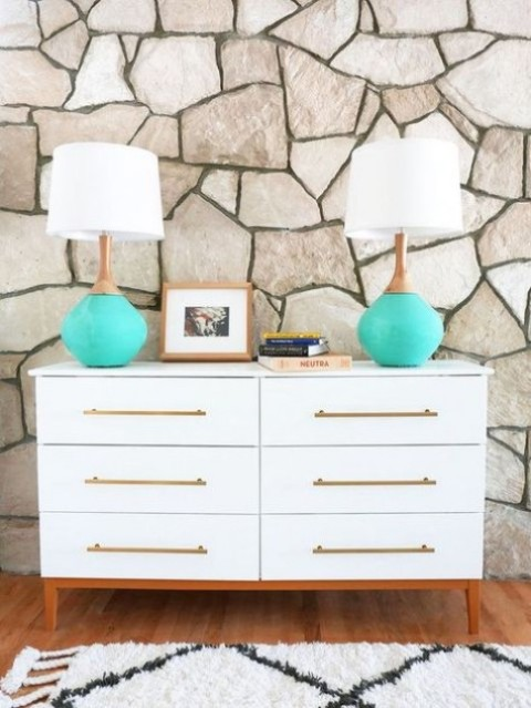 a mid-century modern Tarva hack with long brass handles and colored legs is elegant and chic
