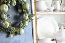 a simple fall wreath of green apples, berries, leaves and a plaid ribbon is farmhouse-like and easy to DIY