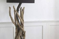 a stylish floor lamp of driftwood, with a black lampshade is a beautiful way to reuse driftwood and add a natural feel to the interior