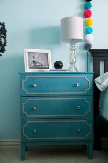 a turquoise IKEA Tarva dresser hack into a nightstand, with white inlays and silver knobs