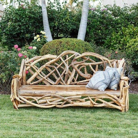 a unique garden bench made of driftwood, with printed pillows is an interesting solution and it lets reuse some simple driftwood