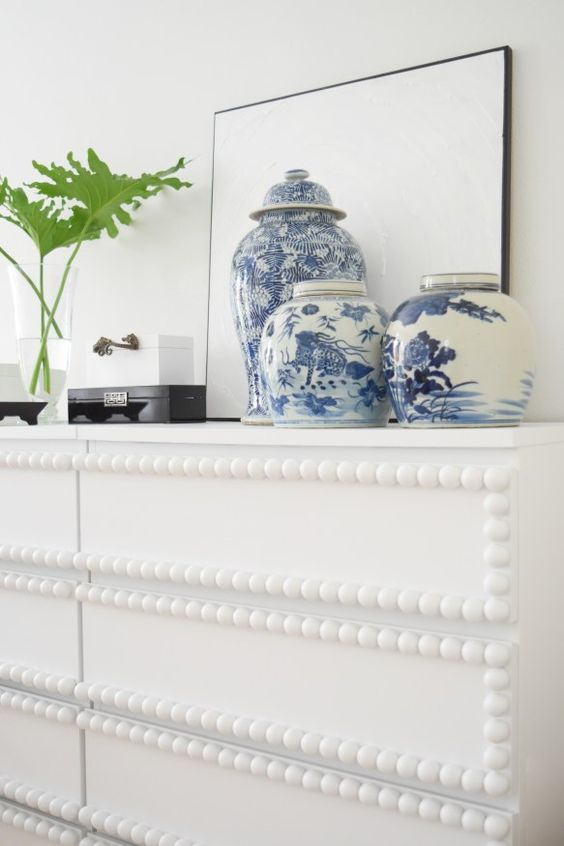 a whimsy IKEA Malm hack with bead trim is a unique idea that catches and eye in any space