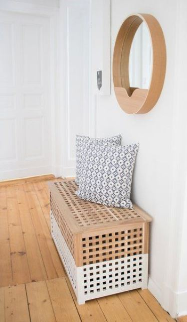 an IKEA Hol table hacked with white paint can be used as a bench in the entryway and feature some storage