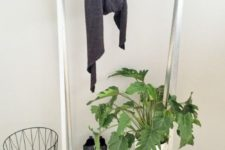 an IKEA Hyllis hack into a simple and minimal entryway rack for hanging clothes and storing shoes