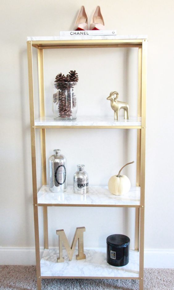 an IKEA Hyllis hack with gold spray paint and marble contact paper is a veyr glam and chic idea