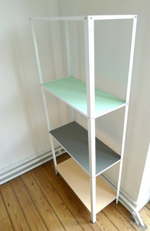 an IKEA Hyllis shelf hacked in tan, grey and mint is a very bold and fun idea