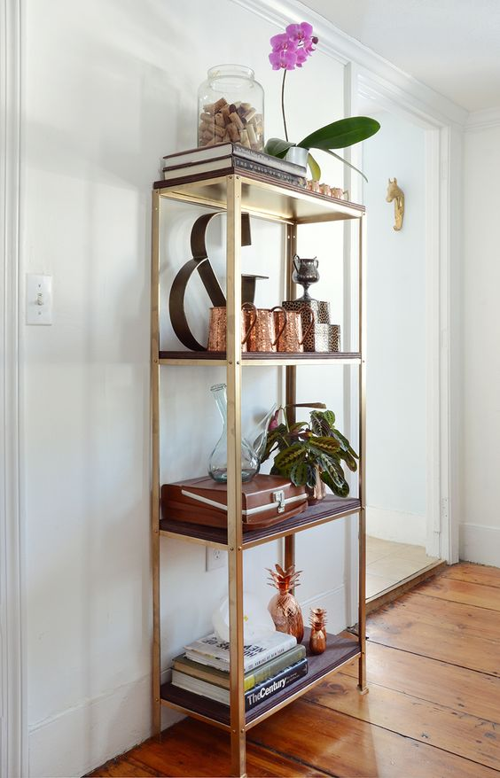 an IKEA Hyllis shelf hacked with gold paint and dark stained shelves brings a touch of rustic glam