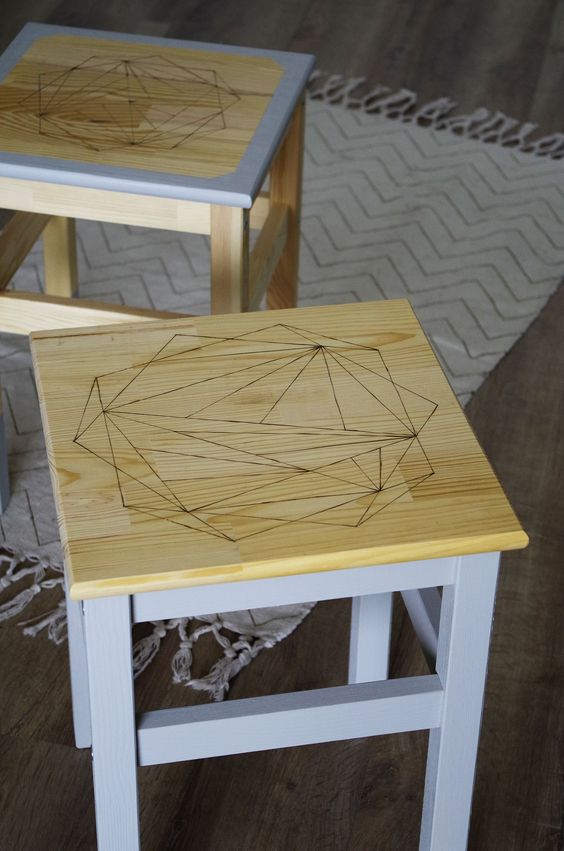 an IKEA Oddvar stool hacked with grey paint, with a geometric stained seat