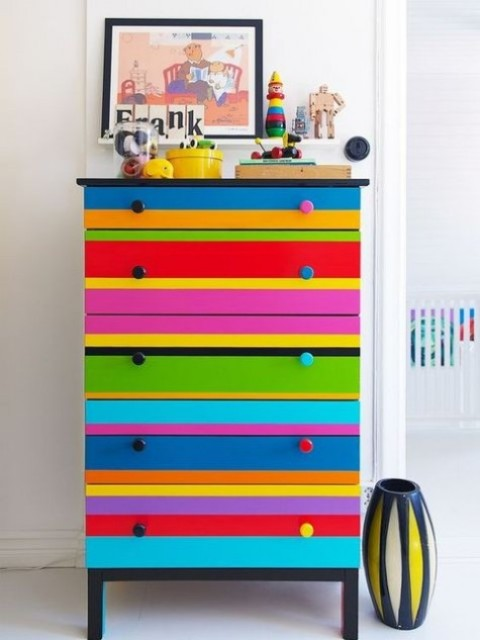 colorful striped Tarva dresser hack with bold knobs is a fun and whimsy piece, ideal for a kid's room