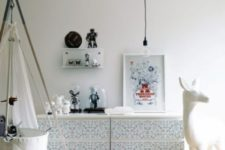 decorate your Malm dresser with printed wallpaper or just contact paper to make it fit a kids' room