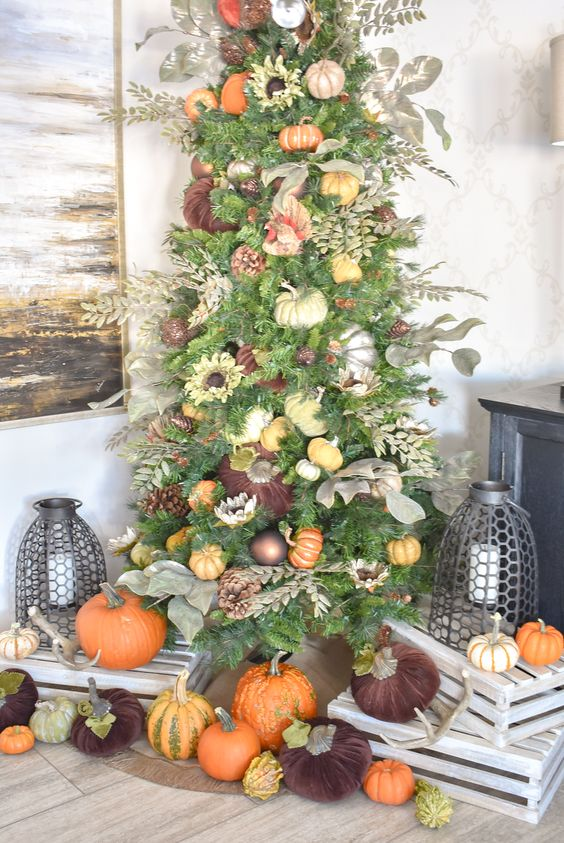 a Thanksgiving tree decorated with ornaments, faux pumpkins, pinecones, faux leaves and foliage is a chic idea