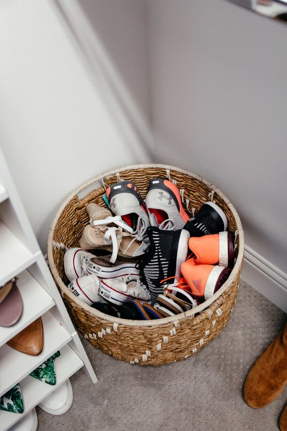 a basket for storing shoes is a simpel way to roganize   you can place it anywhere you want
