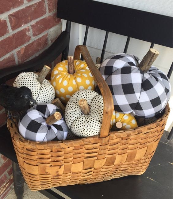 a basket with faux pumpkins of plaid and polka dot fabric are stylish for fall or Halloween