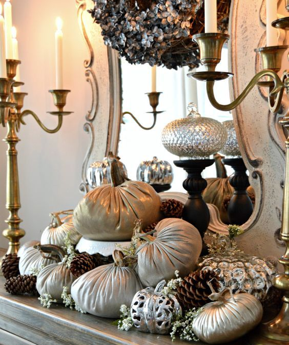 a beautiful fall arrangement of fabric and metallic pumpkins, blooms and pinecones for a refined vintage-inspired space
