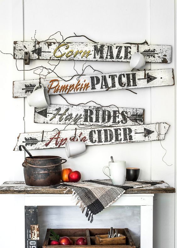 a bunch of white and black fall signs with mugs hanging on them look very relaxed and farmhouse-like