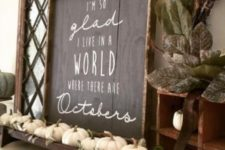 a chic chalkboard sign with white letters, a tray with white pumpkins and leaves for a fall mantel
