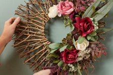 a chic fall wreath of twigs and sticks, greenery and blooms is a beautiful decoration to DIY
