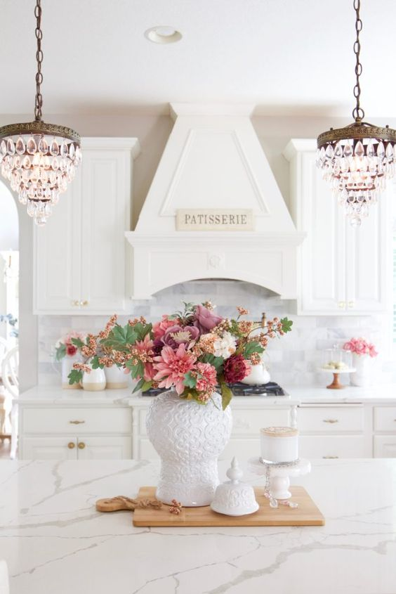 a chic monochromatic floral centerpiece of pink, dusty pink, burgundy and white blooms and greenery for the fall