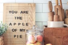 a contemporary fall sign of a light-stained wooden piece and black letters for a fall kitchen