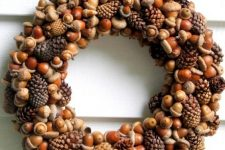 a cool natural fall wreath of acorns, nuts and pinecones is a timeless and long-lasting idea to try