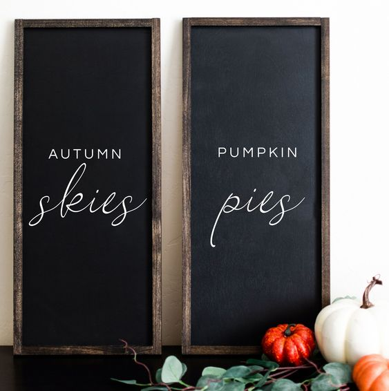 a duo of chalkboard signs with white letters is a stylish idea to spruce up your mantel for the fall