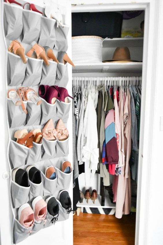 a fabric organizer on the closet door is great to store shoes or accessories, it's modern, simple and saves floor and shelf space