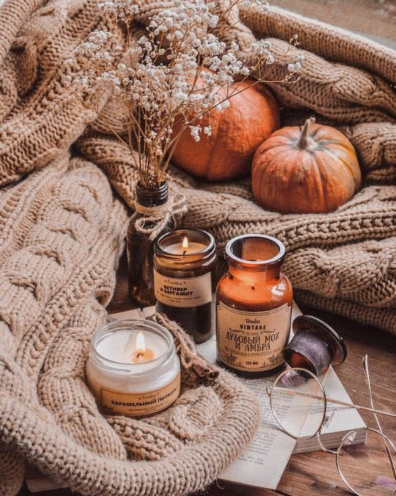 a fall arrangement of candles and baby's breath in a bottle is a great idea for the fall
