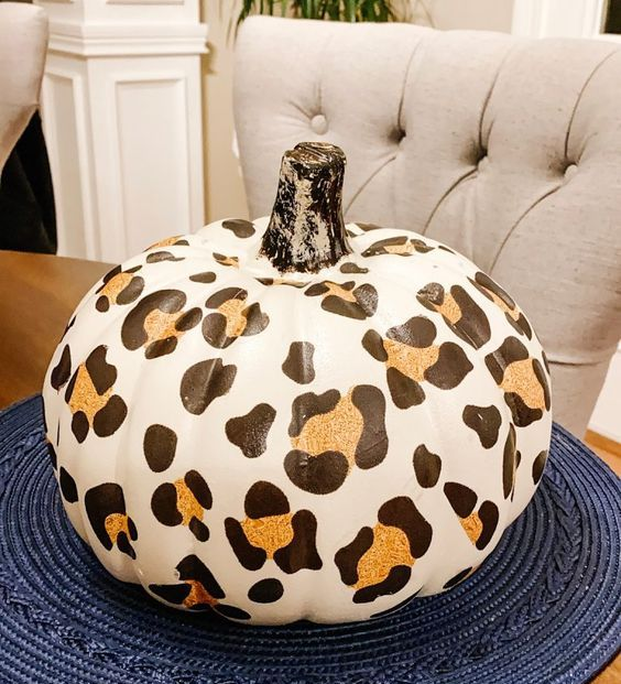a faux pumpkin with a cheetah print is a bold and trendy idea to decorate your home for the fall
