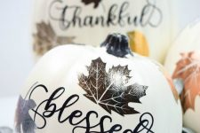 a faux pumpkin with calligraphy and bright and shiny lead stencils is a fantastic fall decoration