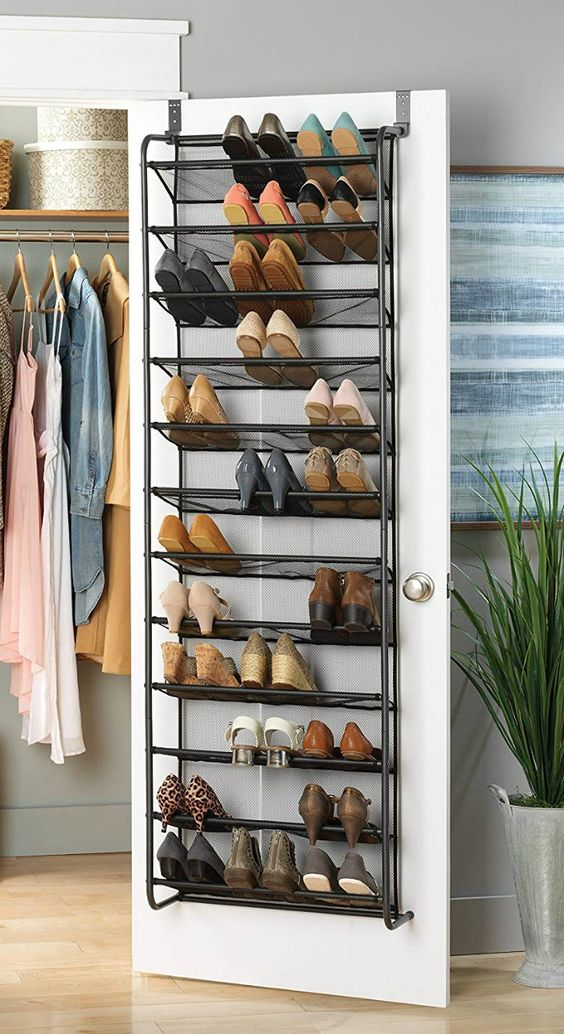 a forged shoe shelf attached to a clsoet door is a smart way to store a lot of shoes without using any floor space