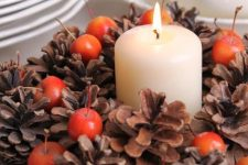 a chic fall centerpiece with pinecones
