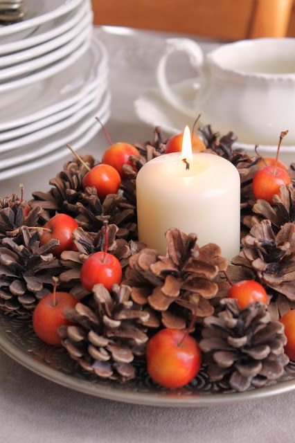 a great and easy fall centerpiece of a chic plate with pinecones, cherries and a pillar candle is fresh and non-typical