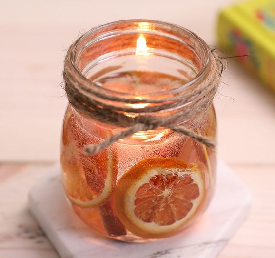 a jar with cinnamon, citrus, a floating candle is a gorgeous solution for a fall space, it will fill it with aromas
