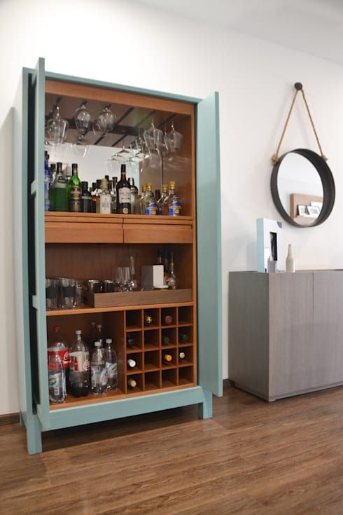 a light blue home bar cabinet with open shelves and a tray plus a mirror backsplash is a stylish idea