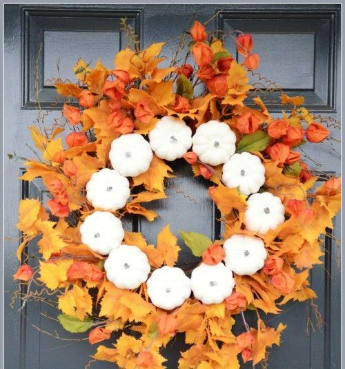 a lush fall wreath of faux leaves, dried blooms and faux pumpkins is a lovely fall decoration for your front door