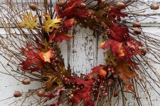 a lush twig fall wreath with bright faux leaves, acorns and berries will brign much color to the porch