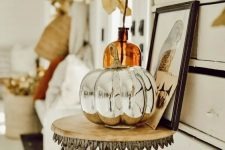 a mercury glass faux pumpkin is a stylish and shiny decoration you may create for the fall, it's chic and vintage-inspired