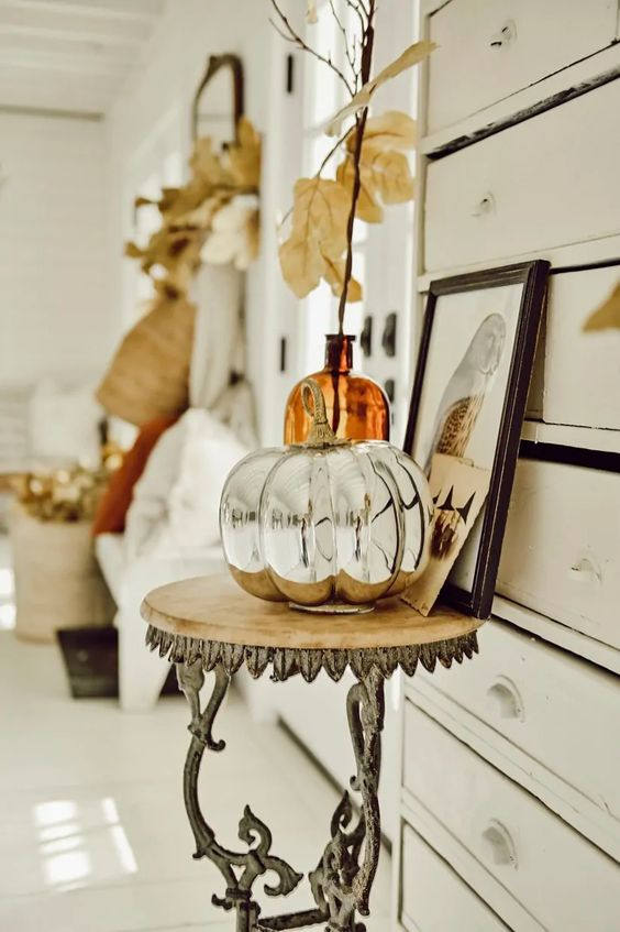 a mercury glass faux pumpkin is a stylish and shiny decoration you may create for the fall, it's chic and vintage inspired