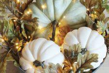 a metal bathtub with faux pumpkins, oak leaves and acorns, lights is a stylish rustic arrangement to rock
