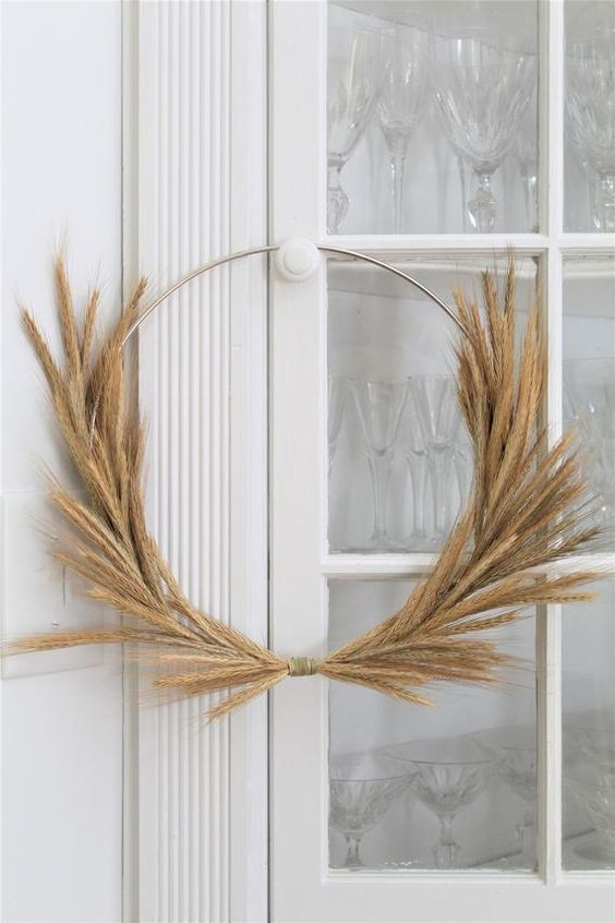 a metal wreath form with wheat makes a nice wreath for the front door and looks chic