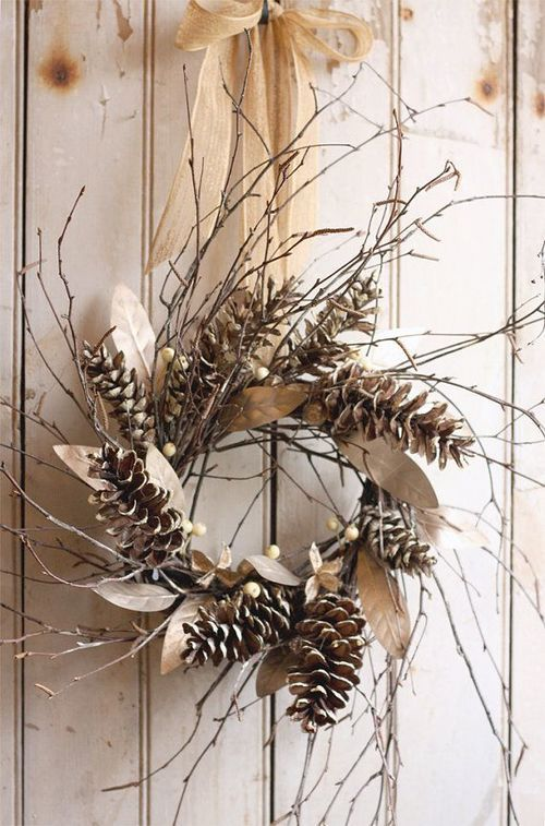 a rustic fall wreath of twigs, berries and pinecones plus dried leaves and a burlap bow is lovely and easy