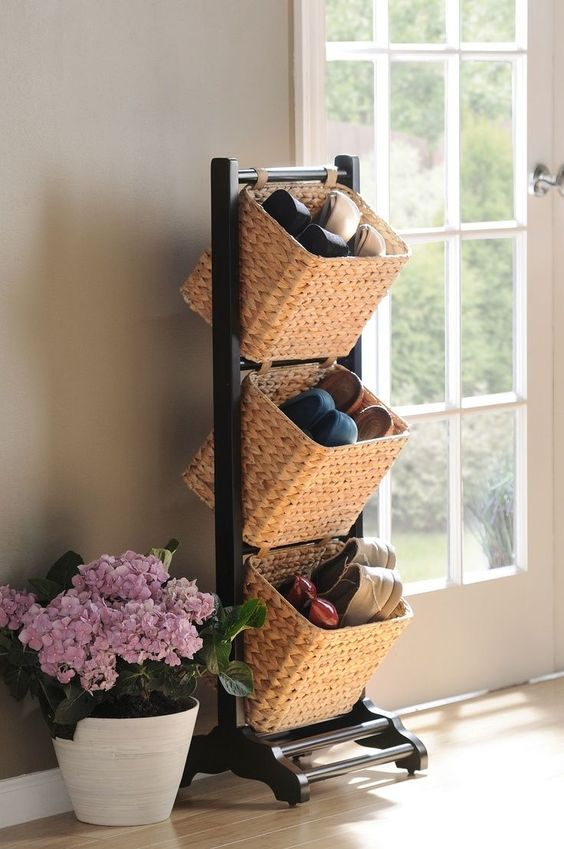 a shoe storage unit with several baskets is an elegant and cool unit for an entryway or closet