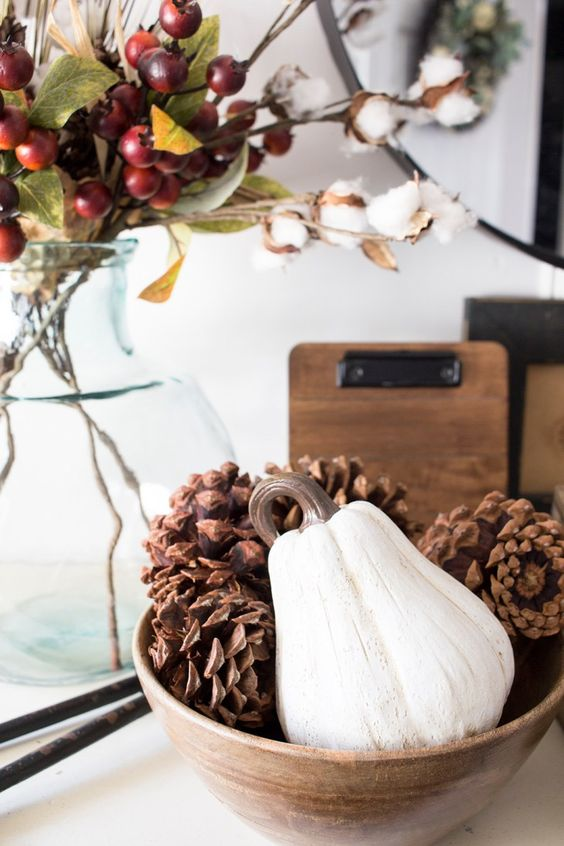 a simple fall centerpiece of a wooden bowl with large pumpkins and a white gourd is a cool all-natural idea